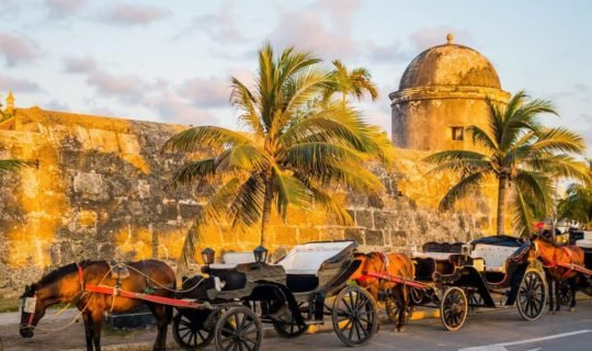 horse-drawn-carriages-in-front-of-historic-colombian-fort