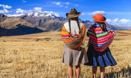 two-indigenous-women-looking-out-at-sacred-valley