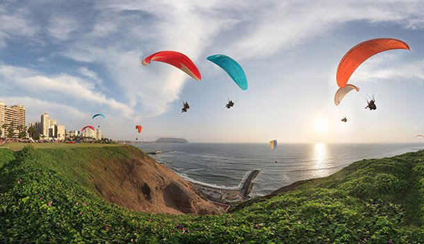 paragliding over lima peru at sunset
