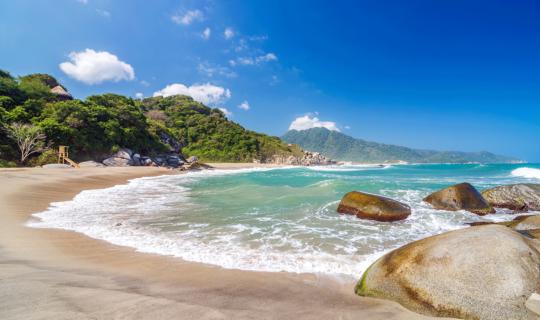 waves crashing onto the shores of a beach at Tayrona National Park