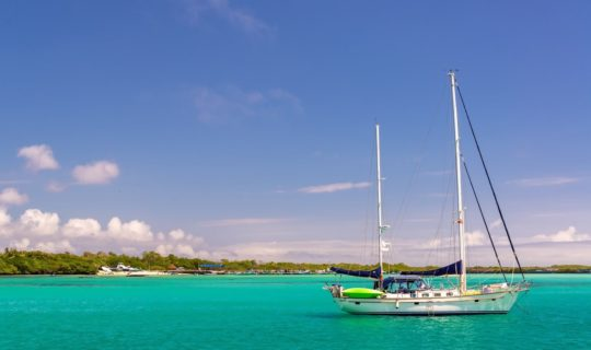 lone-sail-baot-on-crystal-blue-waters-of-galapagos