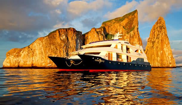 ocean spray galapagos cruise ship in front of the kicker rock