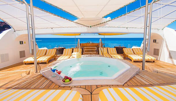 the sundeck and jacuzzi of a galapagos cruise