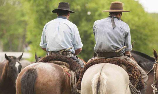 two-men-ridding-horses-in-argentina