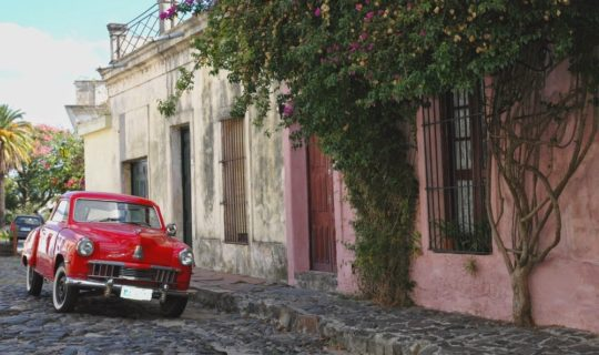 colonia-street-scene-with-classic-red-car-and-old-building-facades