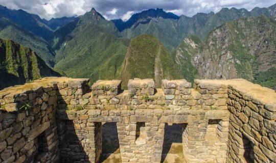 inside-machu-picchu-ruins-overlooking-mountains