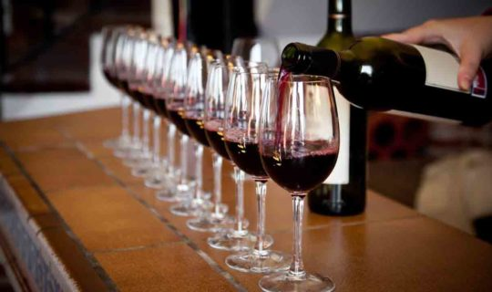 several-wine-glasses-being-filled-with-red-wine