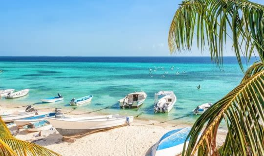 beautiful-beach-with-boats-resting-on-the-shore