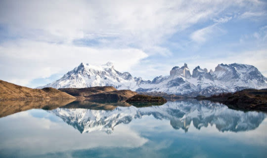 patagonia-mountains-reflecting-off-mountain-lake-in-winter