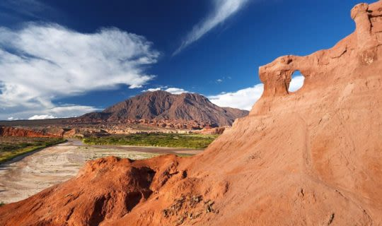 salta-a-dry-desert-in-argentina-with-red-rock-cliffs-and-arches