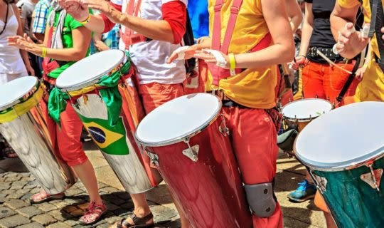 locals-dressed-in-colorful-clothes-and-drumming-during-parade