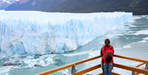 woman standing at viewpoint for Perito Moreno Glacier