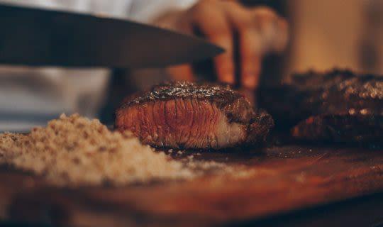 medium-rare-steak-being-cut-by-chef