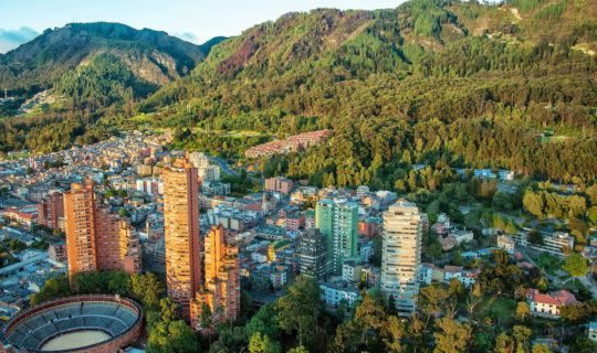 bogota-colombia-high-rises-just-before-steep-green-hill
