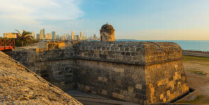 old fort and gun tower with Cartagena city at back