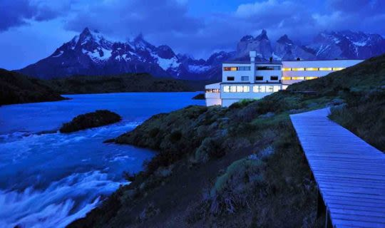 torres-del-paine-at-night-with-distant-mountains-and-lodge