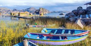 painted boats along lake titicaca