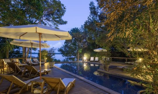beach-resort-in-brazil-with-dark-pool-beside-rock-cliffs