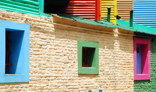 colorful-windows-on-brick-building-in-argentina