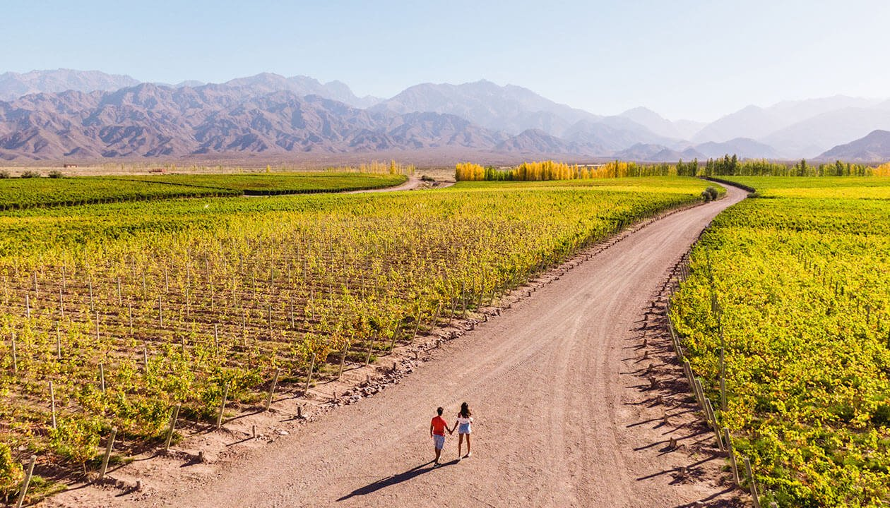 couple walking in mendoza argentina