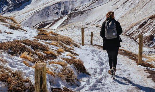 man-beginning-hike-on-mountain