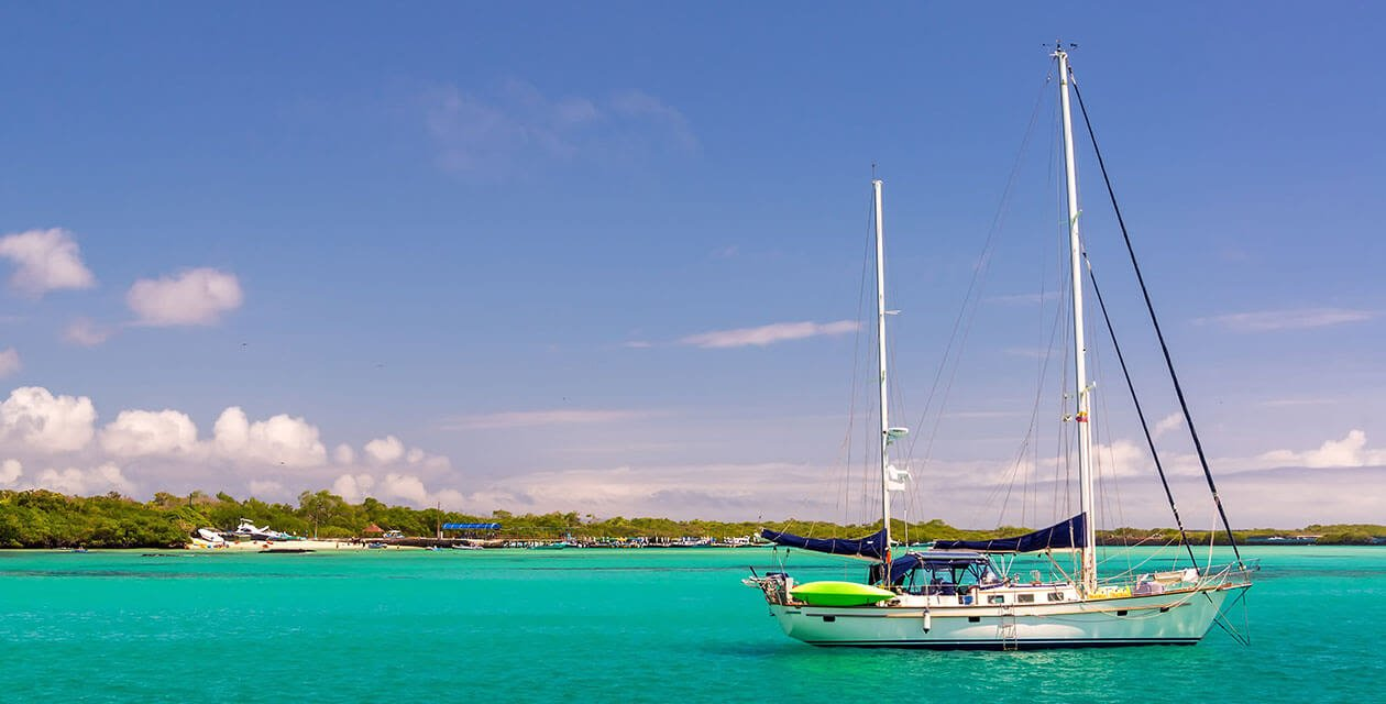 sail boat on blue waters of the Galapagos