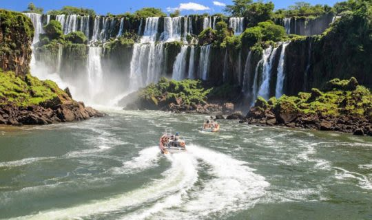 Boats driving to the base of Iguazu Falls
