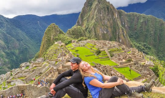 Couple sitting on Machu Picchu Mountain