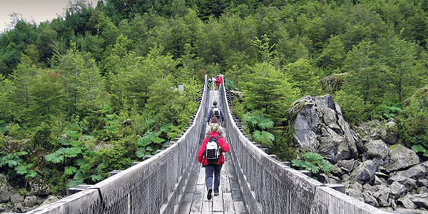Crossing a bridge while on a hike in Patagonia