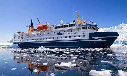 The cruise ship cruises through the icy water of Antarctica