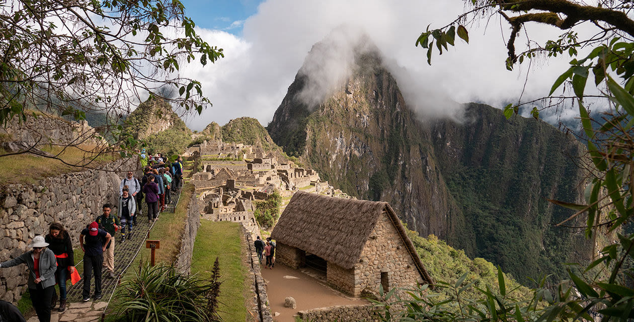 tourists walking around machu picchu