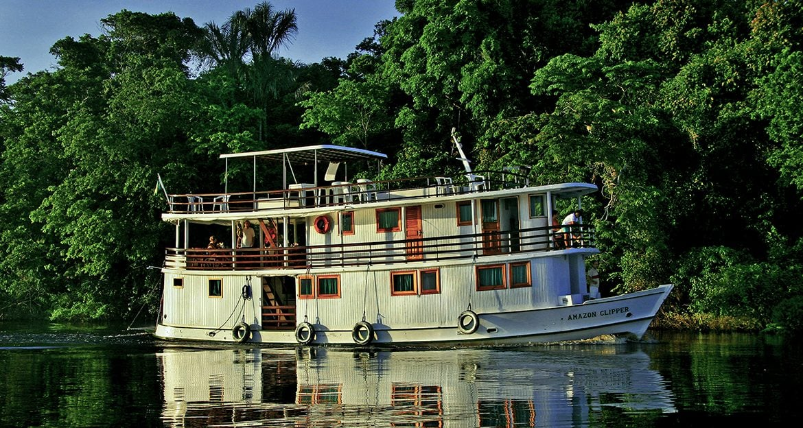 the-cute-clipper-amazon-cruise-approaching-jungle-along-the-river