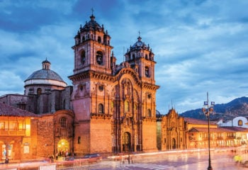 Sunset on the cathedrals in Cusco Peru's city square