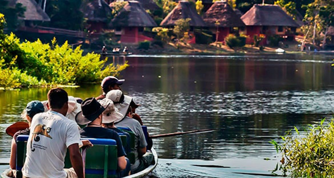 guests-approaching-lodge-in-canoe