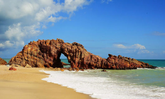 beautiful rock arch over beach