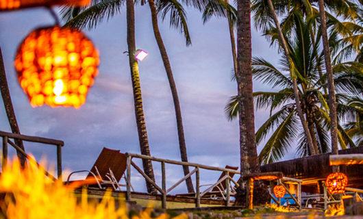 Dusk lit Kiaroa Eco-Luxury Resort outdoor area