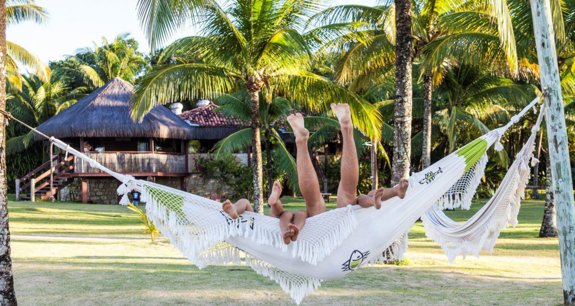 Guests laying on hammock