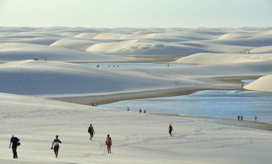 People exploring Lençóis Maranhenses