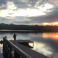 Man enjoying sunset at Napo center waterfront