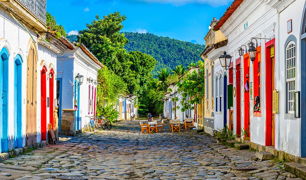 Historic road in Paraty with table and chairs