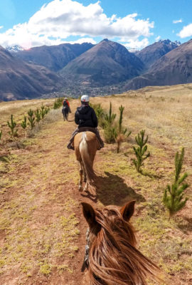 Stunning mountain views while travelers ride on horses through Peru