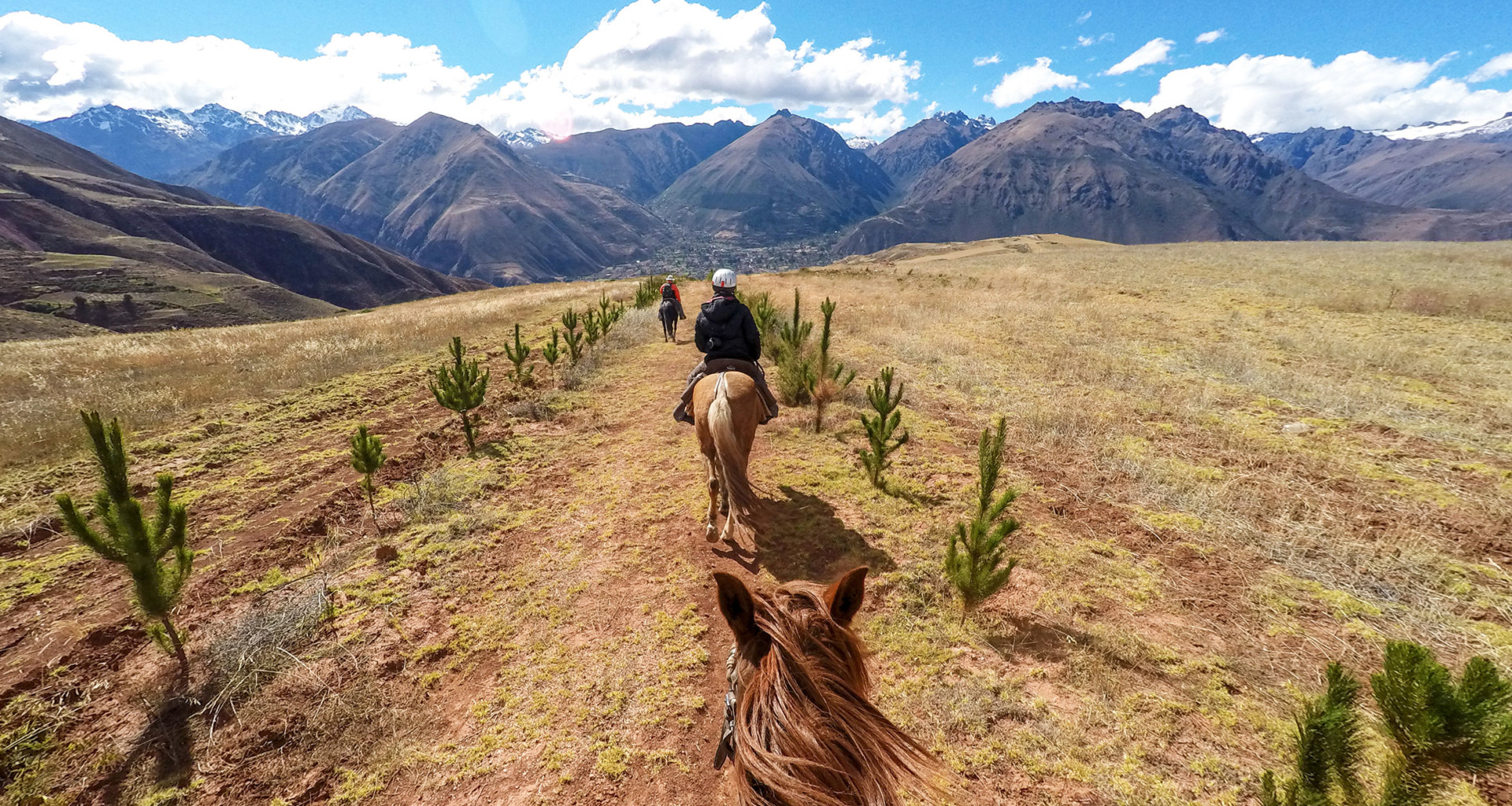 Stunning mountain views while travelers ride on horses through Peru