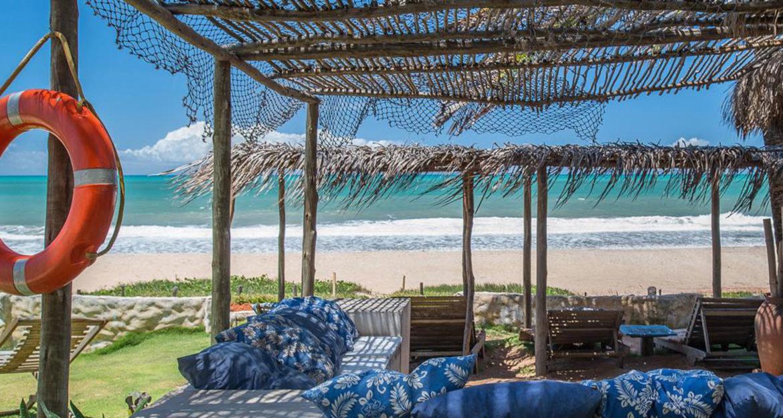 Scenic sitting area along the beach at Pousada Toca da Coruja Brazil Beach Resort