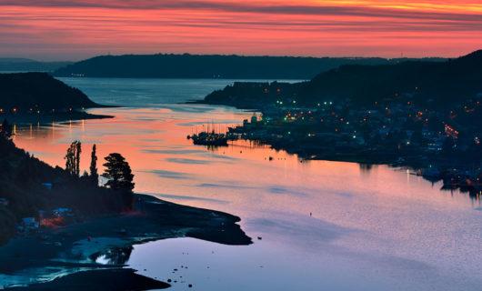 Depart Puerto Montt for Hornopiren with sunset