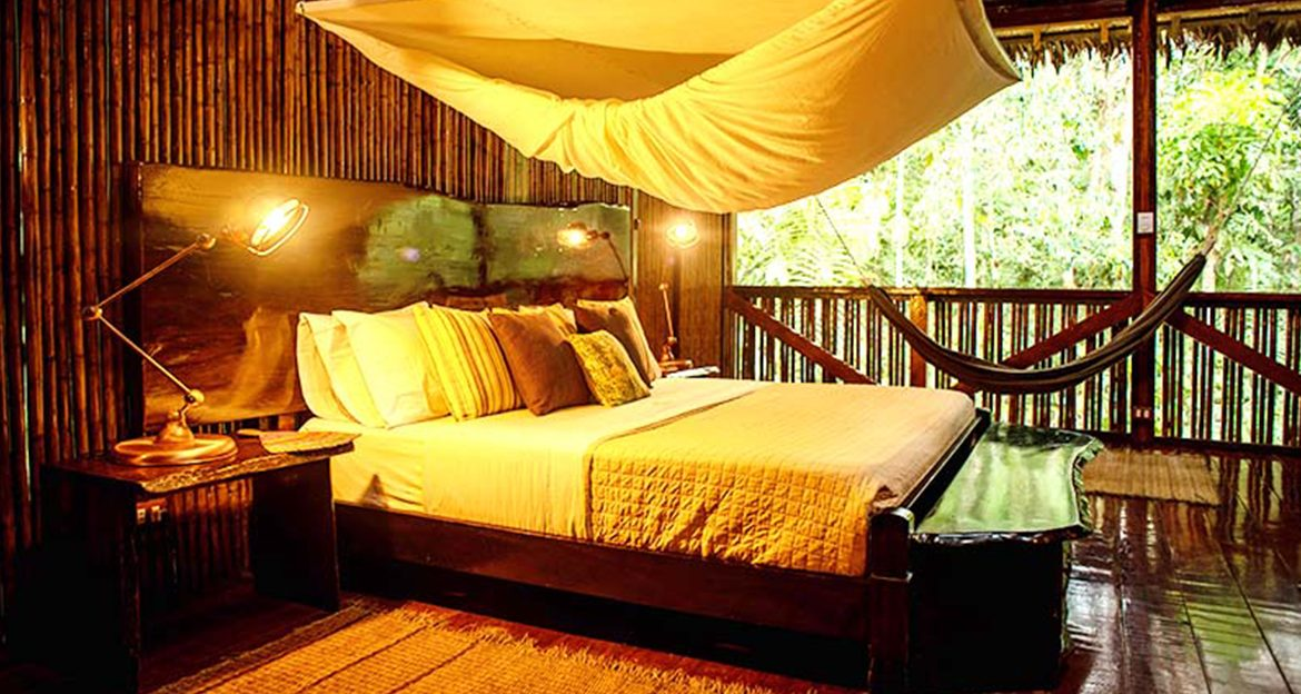 inside-the-refugiosamazonas-bedroom-with-canopy-bed-and-view-of-jungle