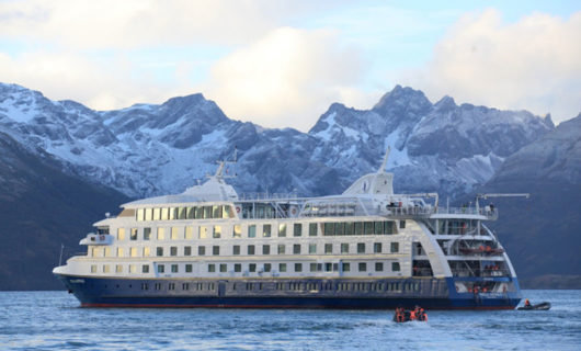 Stella Australis Cruise in ice waters with mountain background
