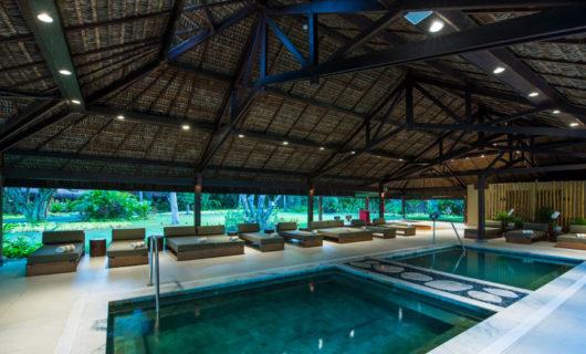 modern pool lounging area in Tivoli Eco-Resort Praia do Forte