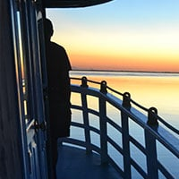 A man watching the sunset on Tucano deck