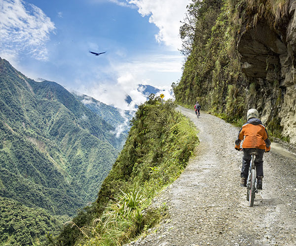 bikers-on-dramatic-mountain-road-in-bolivia