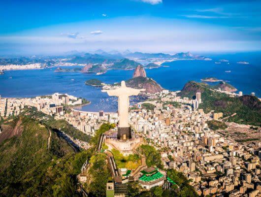 Aerial view of Rio de Janeiro past Christ the Redeemer statue